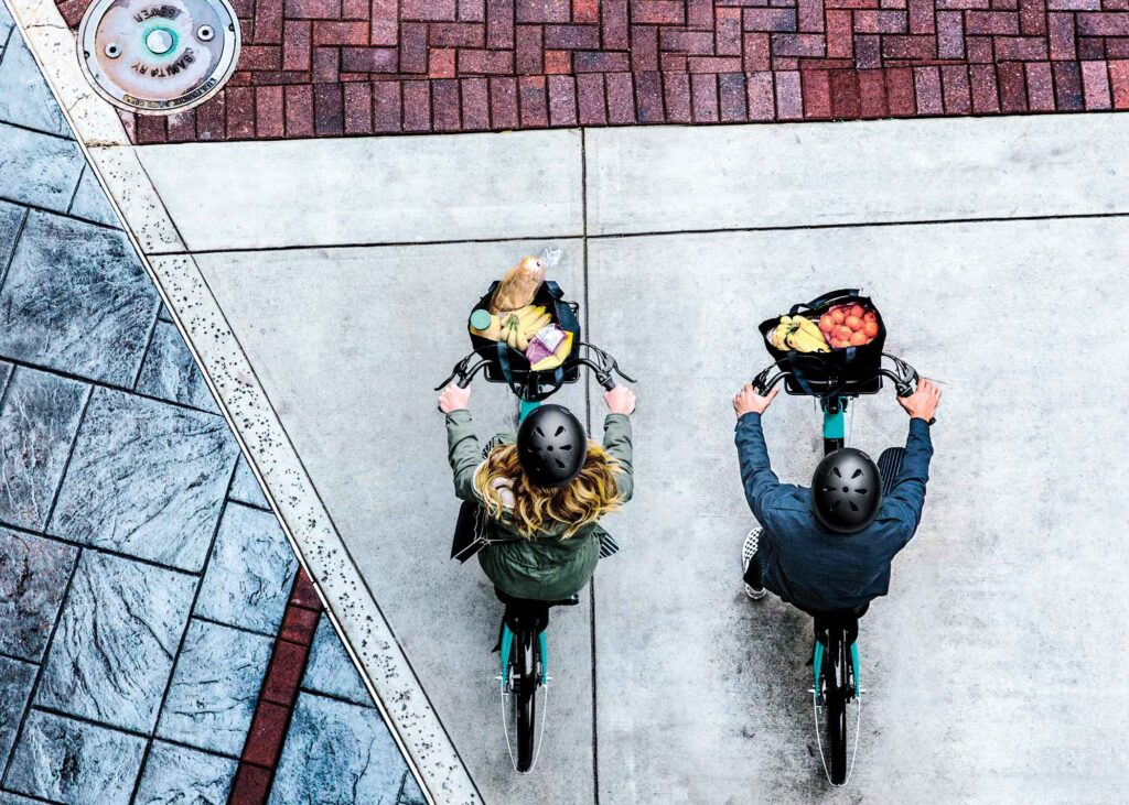 Overhead photo of two bikers with food in their baskets