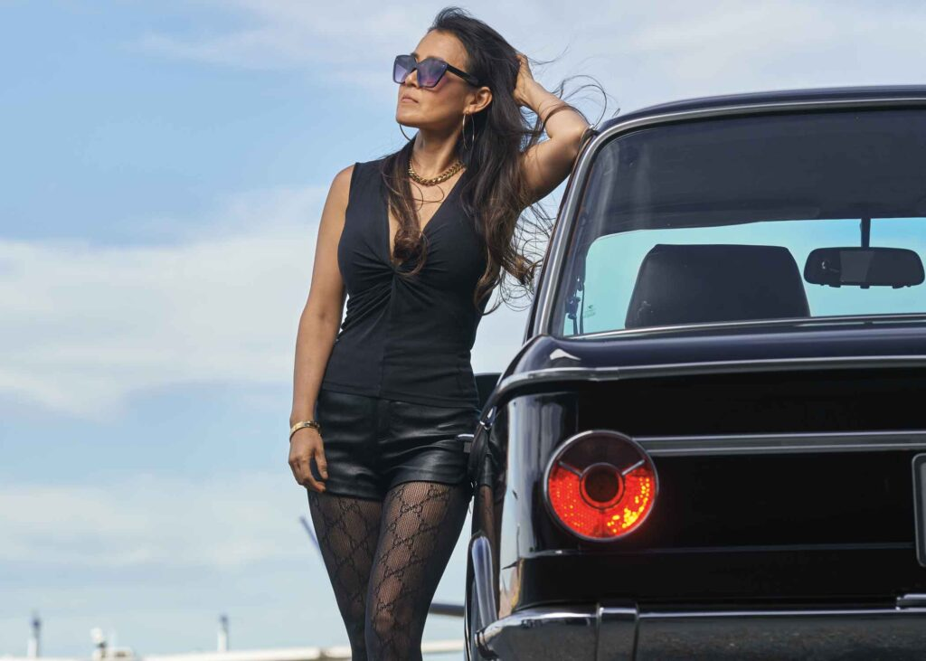 Lisa leaning on her 1973 BMW 2002
