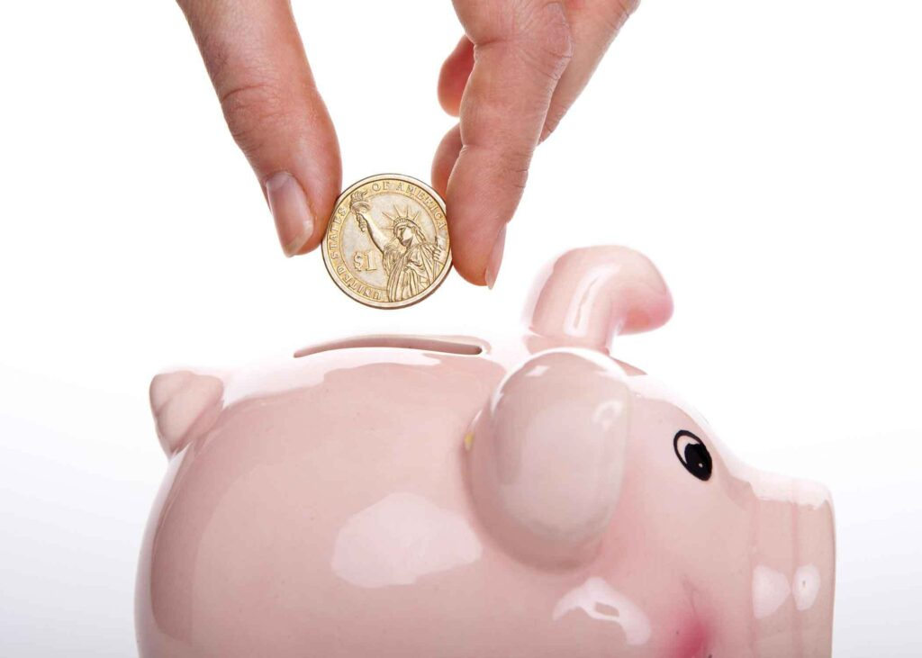 coin being put in piggy bank