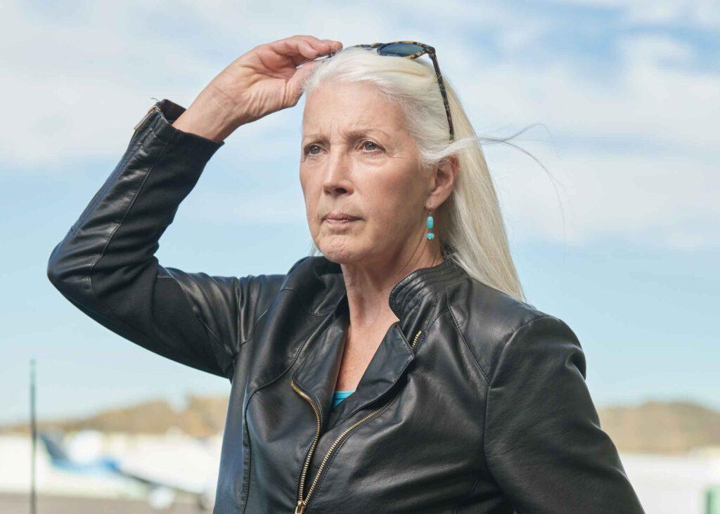 Susan Royce standing in leather jacket
